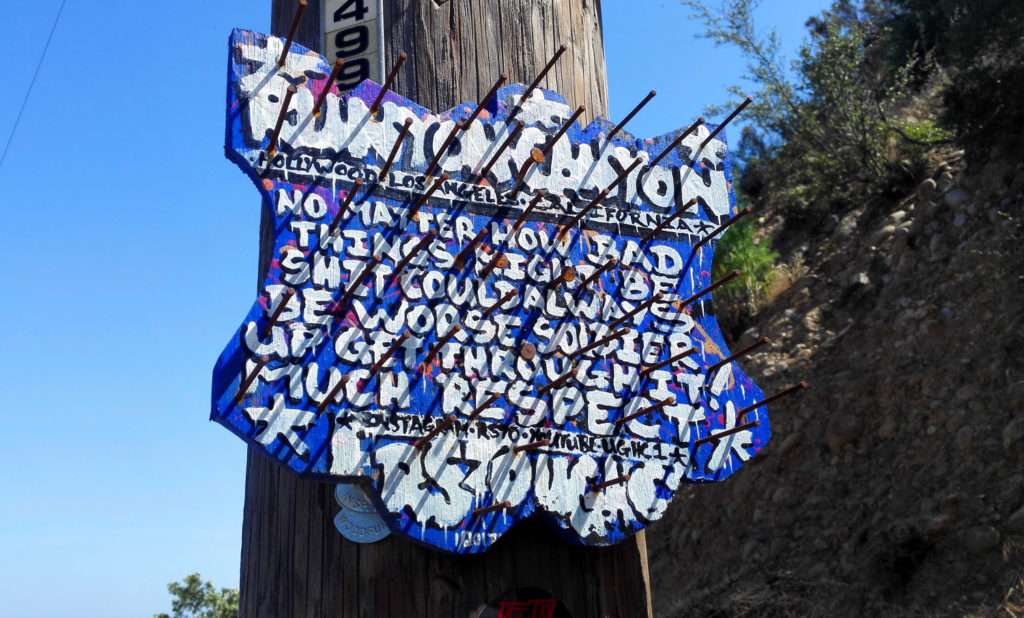 Motivationsschild im Runyon Canyon in Los Angeles